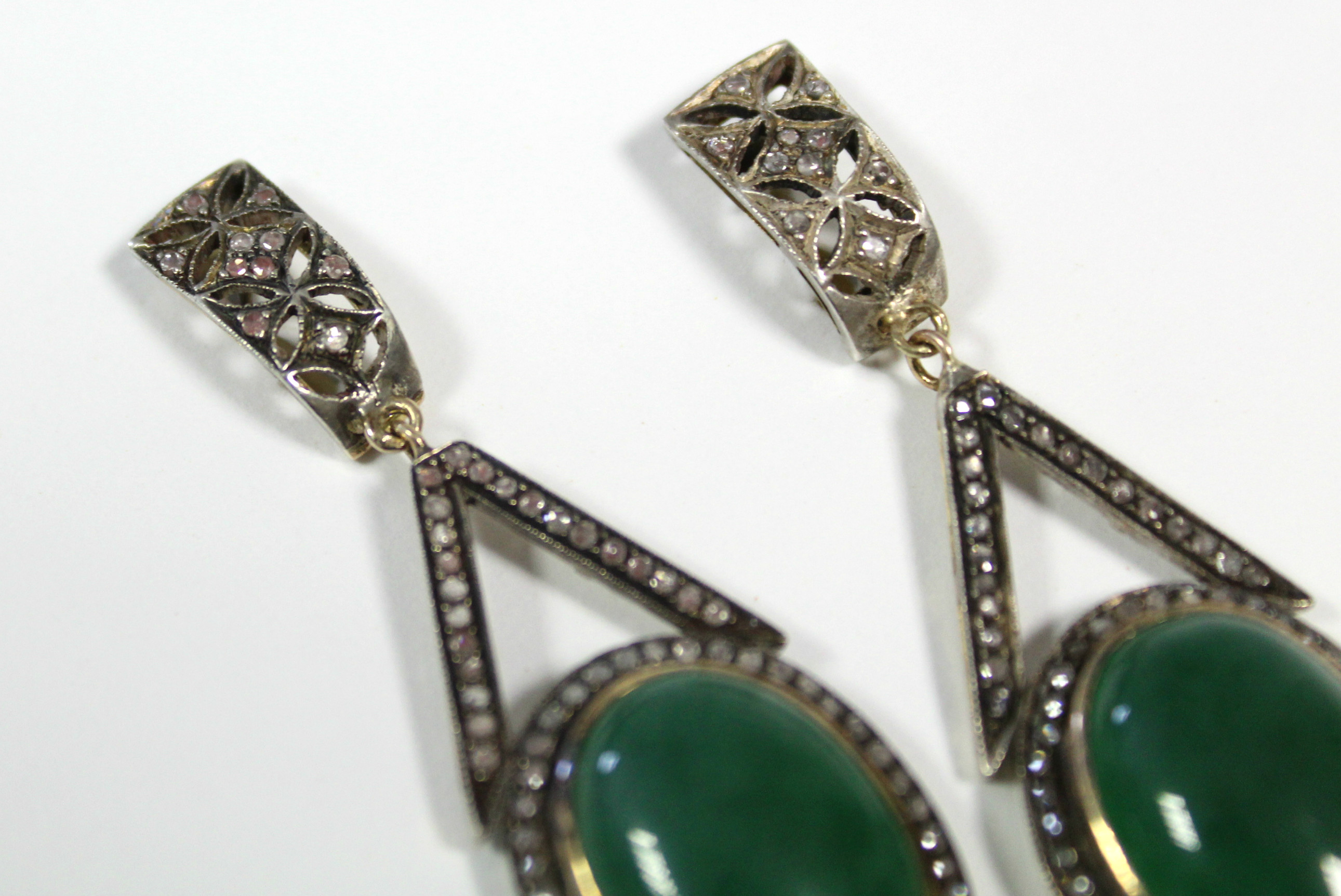 A PAIR OF JADE & DIAMOND PENDANT EARRINGS, each with oval green jade cabochon suspended from an - Image 5 of 6