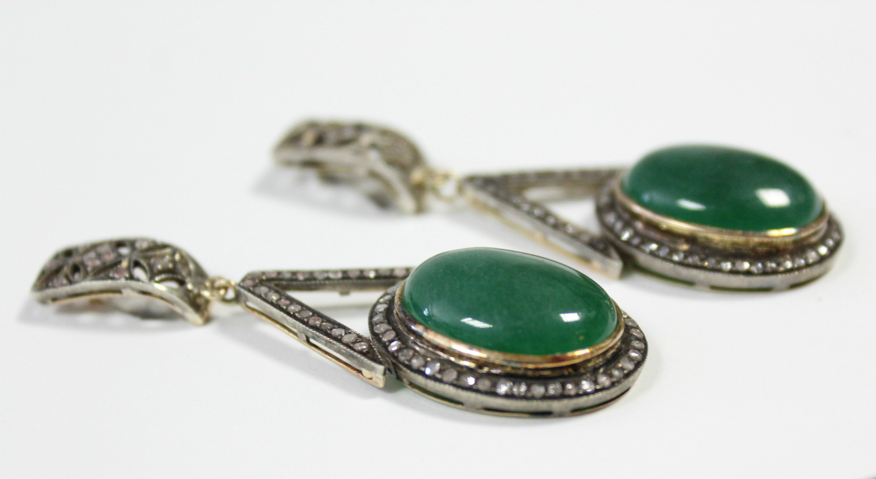 A PAIR OF JADE & DIAMOND PENDANT EARRINGS, each with oval green jade cabochon suspended from an - Image 3 of 6