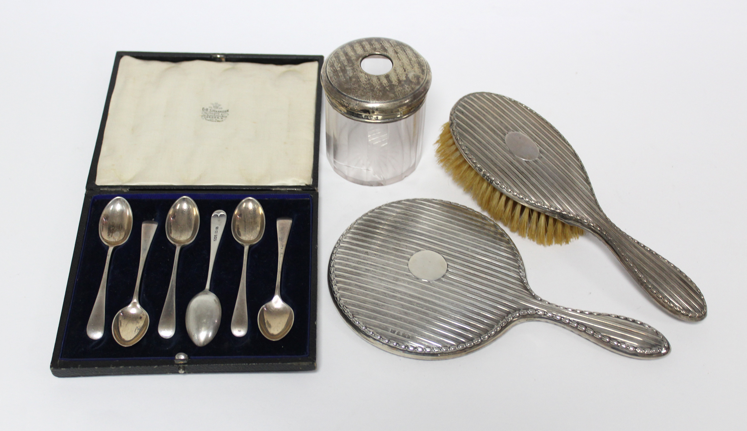 A set of six silver teaspoons in fitted case, Sheffield 1918 by J. Rodgers & Co.; together with a