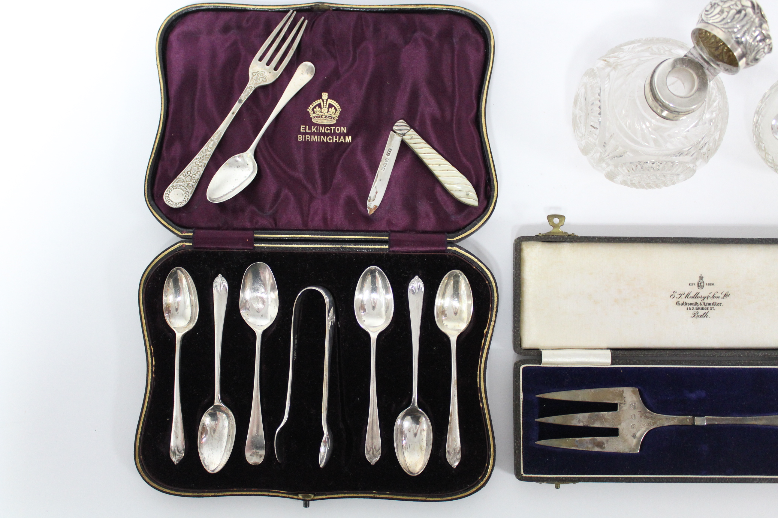 A matched set of six silver teaspoons with matching sugar tongs; Birmingham 1903, by Elkington & Co. - Image 4 of 8