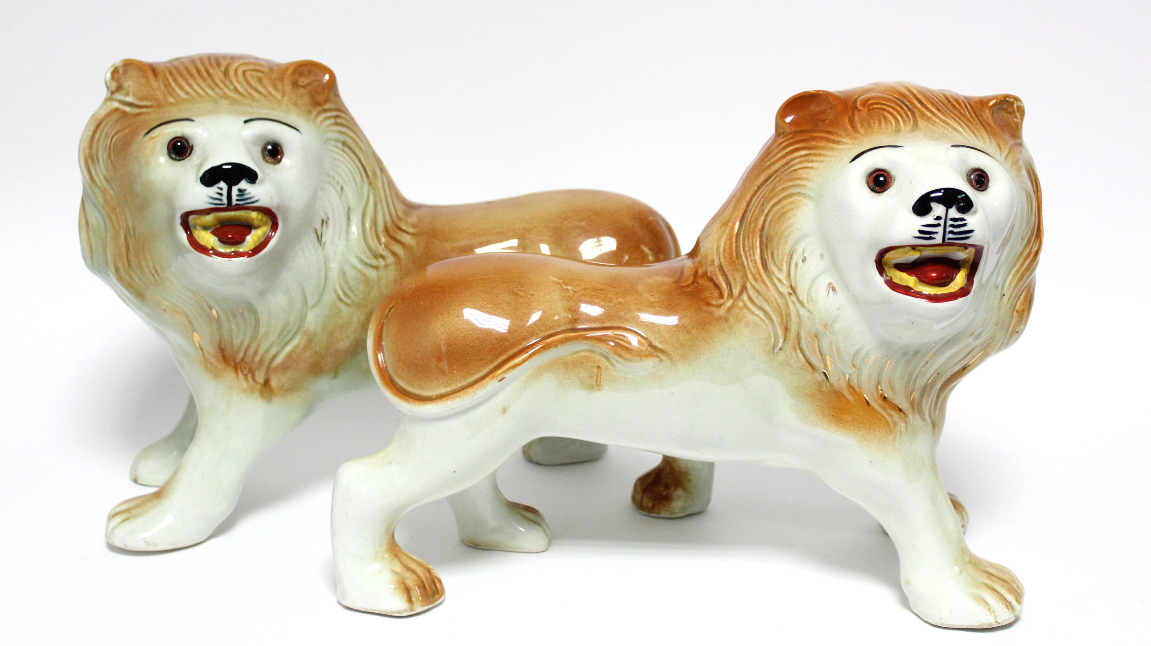 A pair of early 20th century Sadler Pottery large standing models of roaring lions with inset