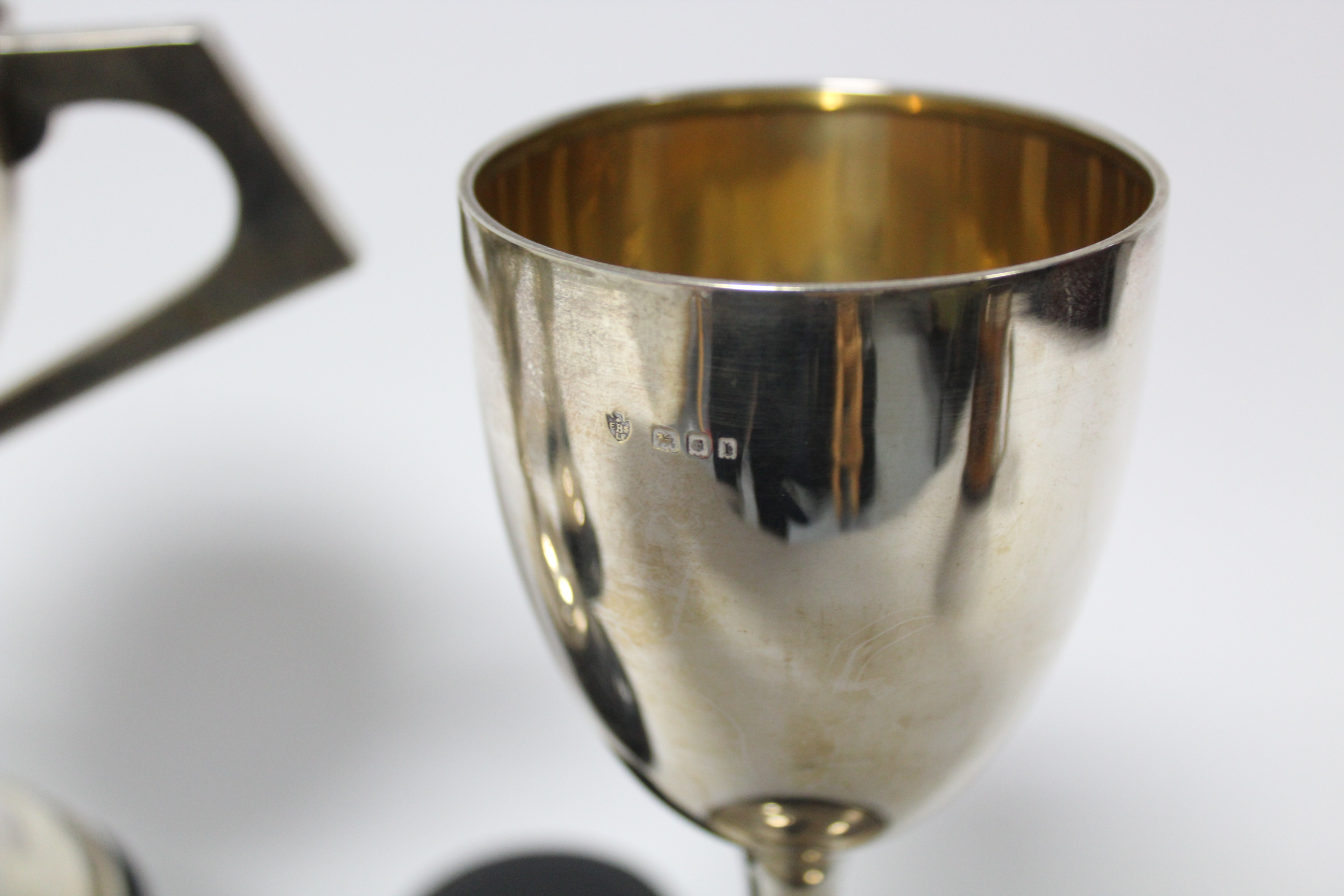A George V two-handled trophy cup, Sheffield 1924, by Fattorini & Sons Ltd; together with three - Image 4 of 5
