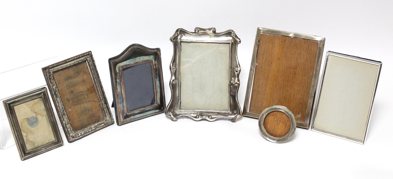 Five various rectangular photograph frames; & a small circular photograph frame, w.a.f.