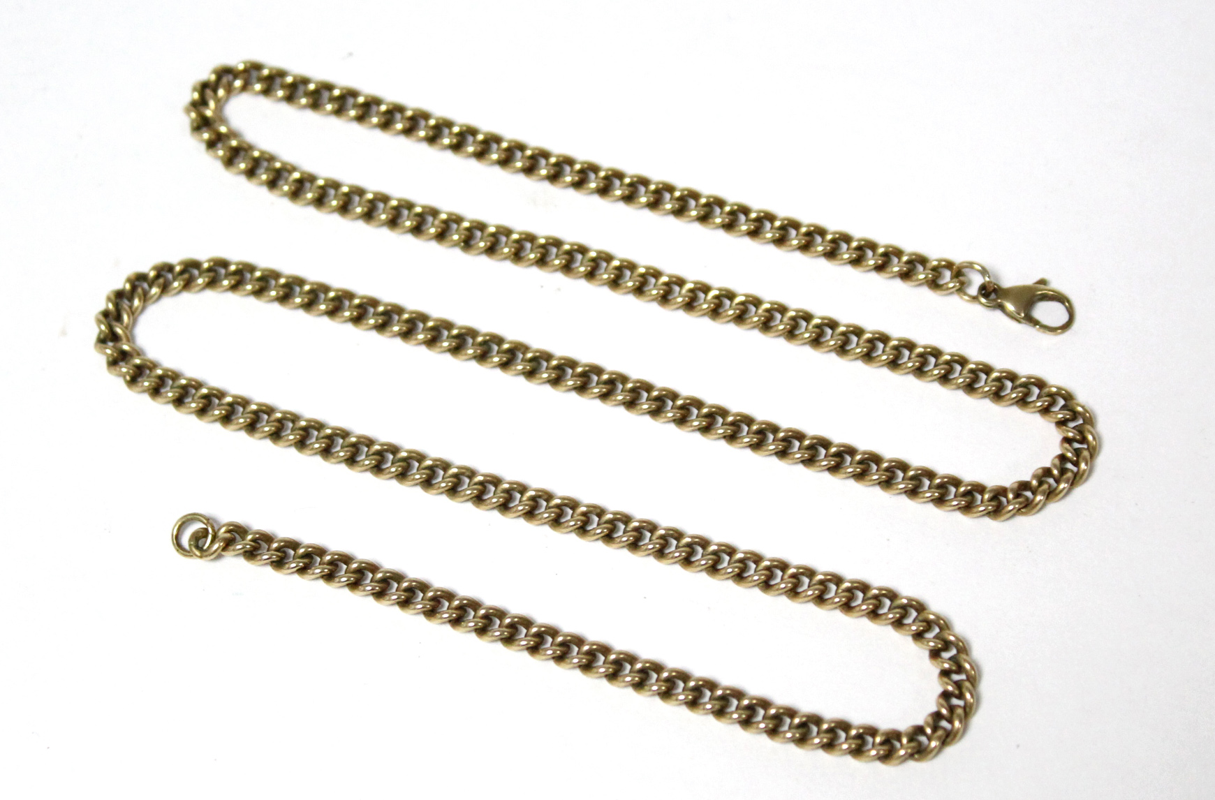"A 9ct. gold curb-link chain, 21"" long (27gm)."