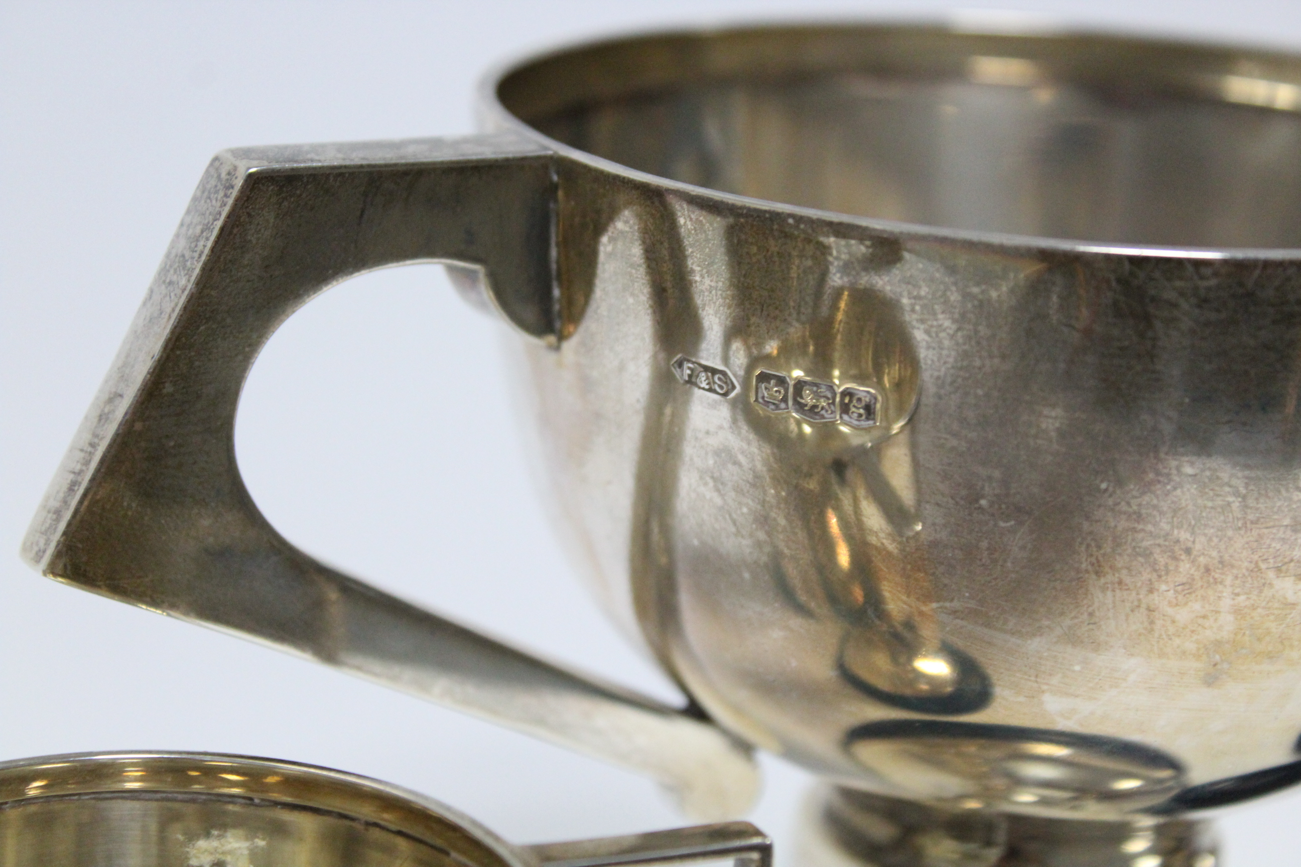 A George V two-handled trophy cup, Sheffield 1924, by Fattorini & Sons Ltd; together with three - Image 3 of 5