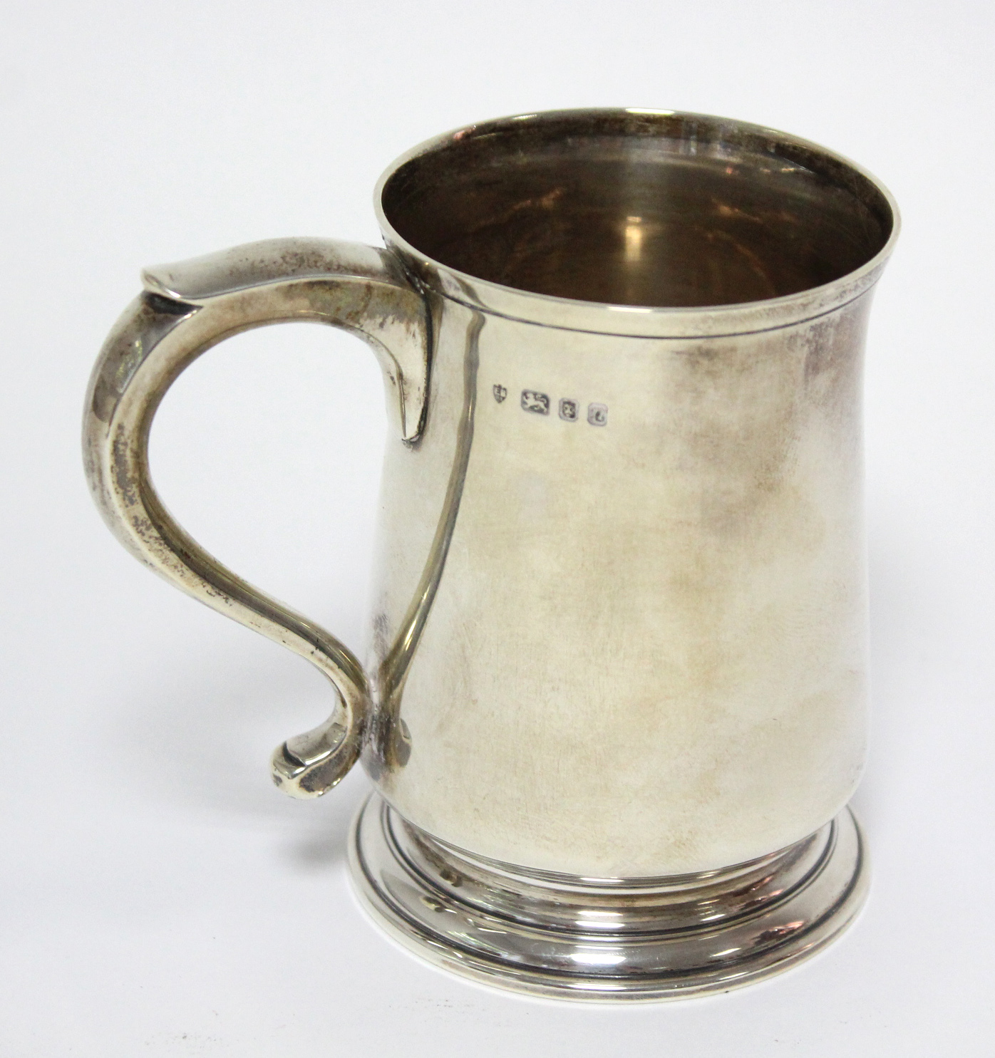 Lot 25 - A modern silver christening mug of baluster shape, with scroll handle & on short round foot; 4""