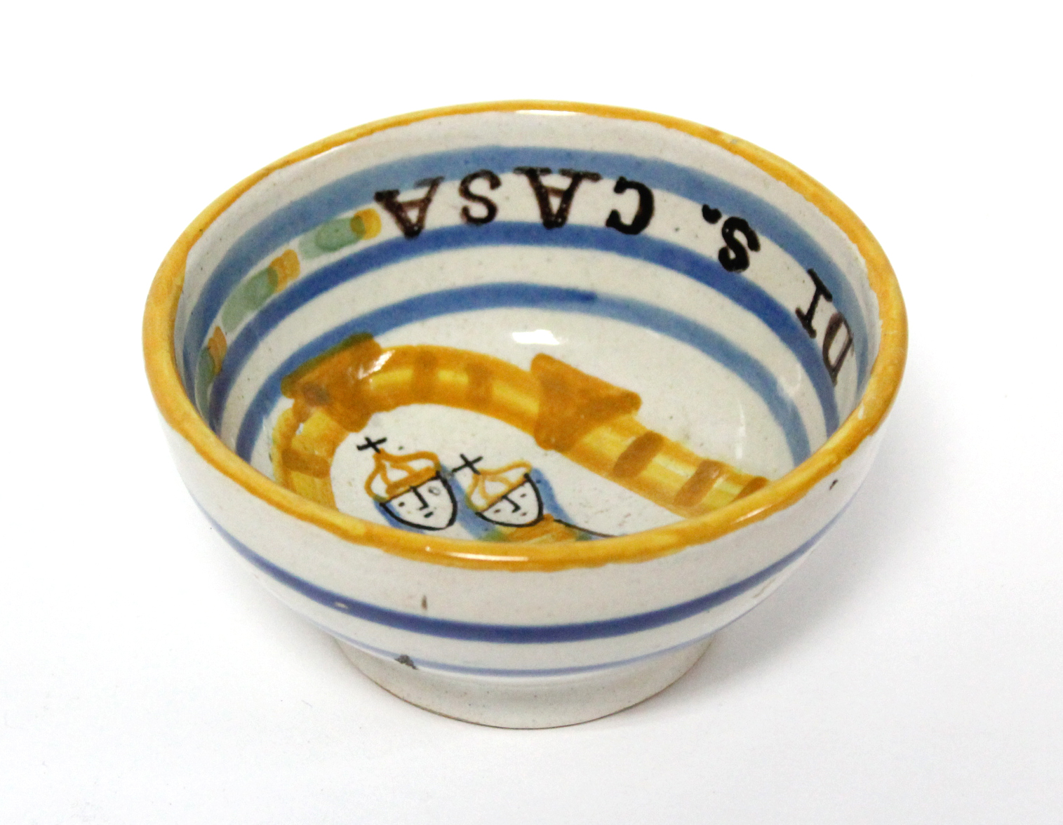 Lot 55 - An Italian polychrome faience pilgrim's bowl, decorated with the Virgin Mary & Child, inscribed: ""