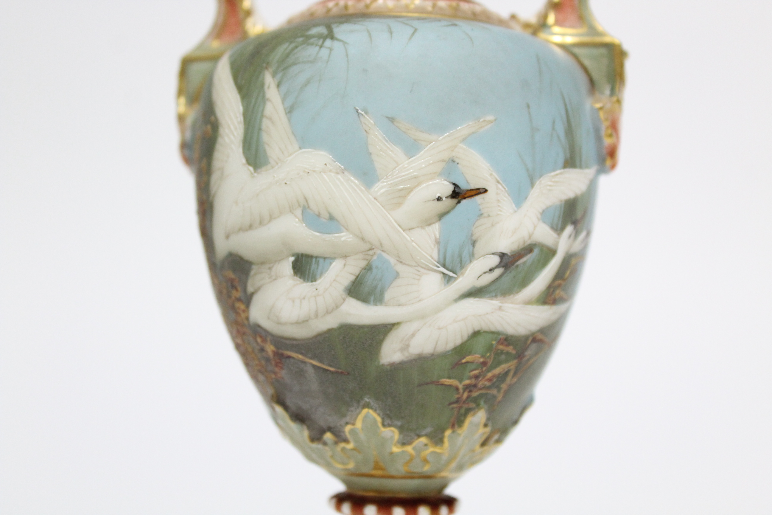 Lot 59 - A Royal Worcester porcelain two-handled ovoid vase painted with swans in flight by C. H. C. BALDWYN,