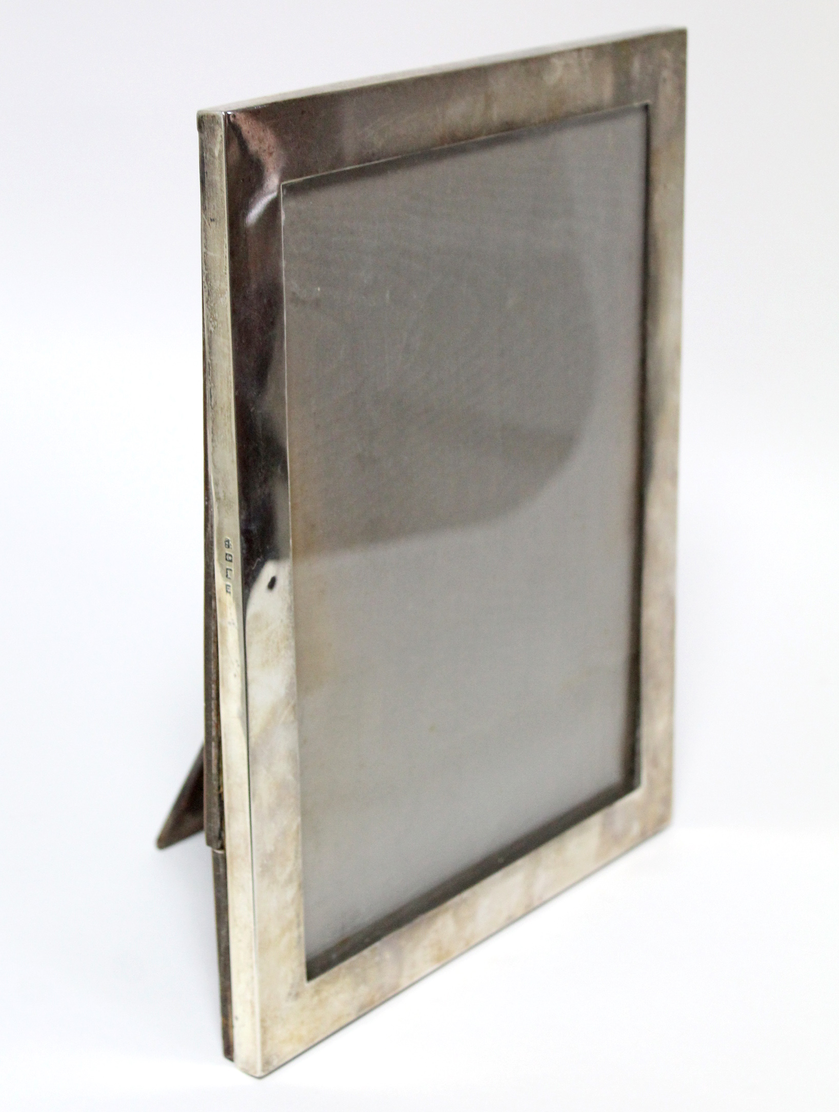 "Lot 9 - A large rectangular photograph frame, 11½"" x 9""; Birmingham 1926, by W. Neale & Sons Ltd."