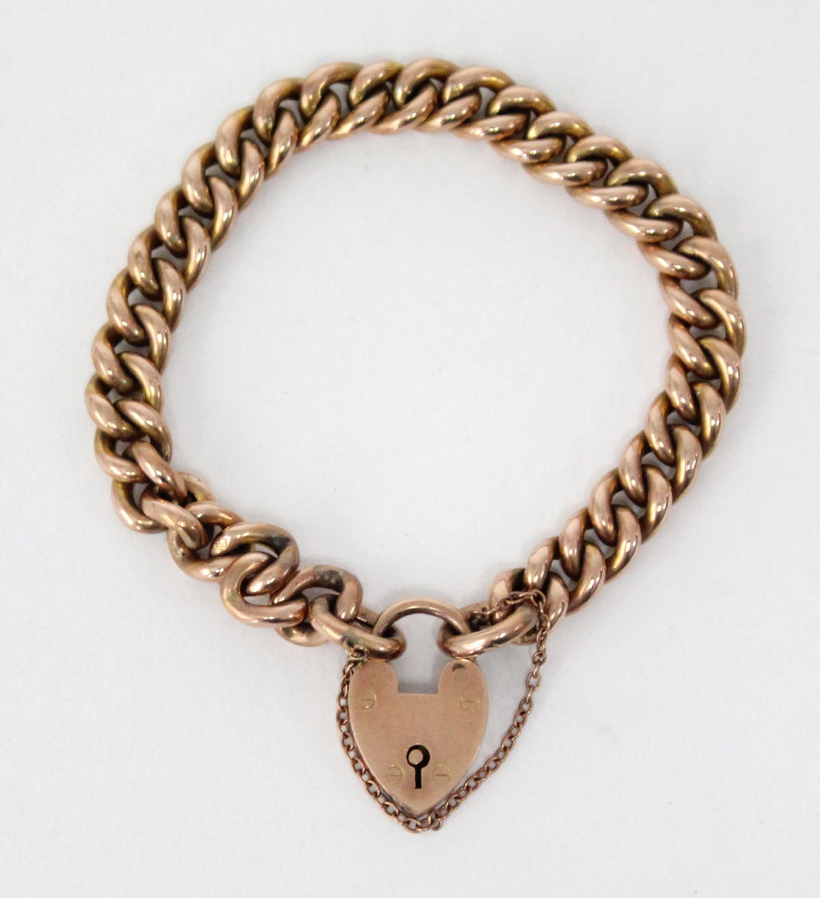 Lot 38 - A 9ct. gold bracelet of hollow curb links, with padlock clasp & safety chain. (17 gm)