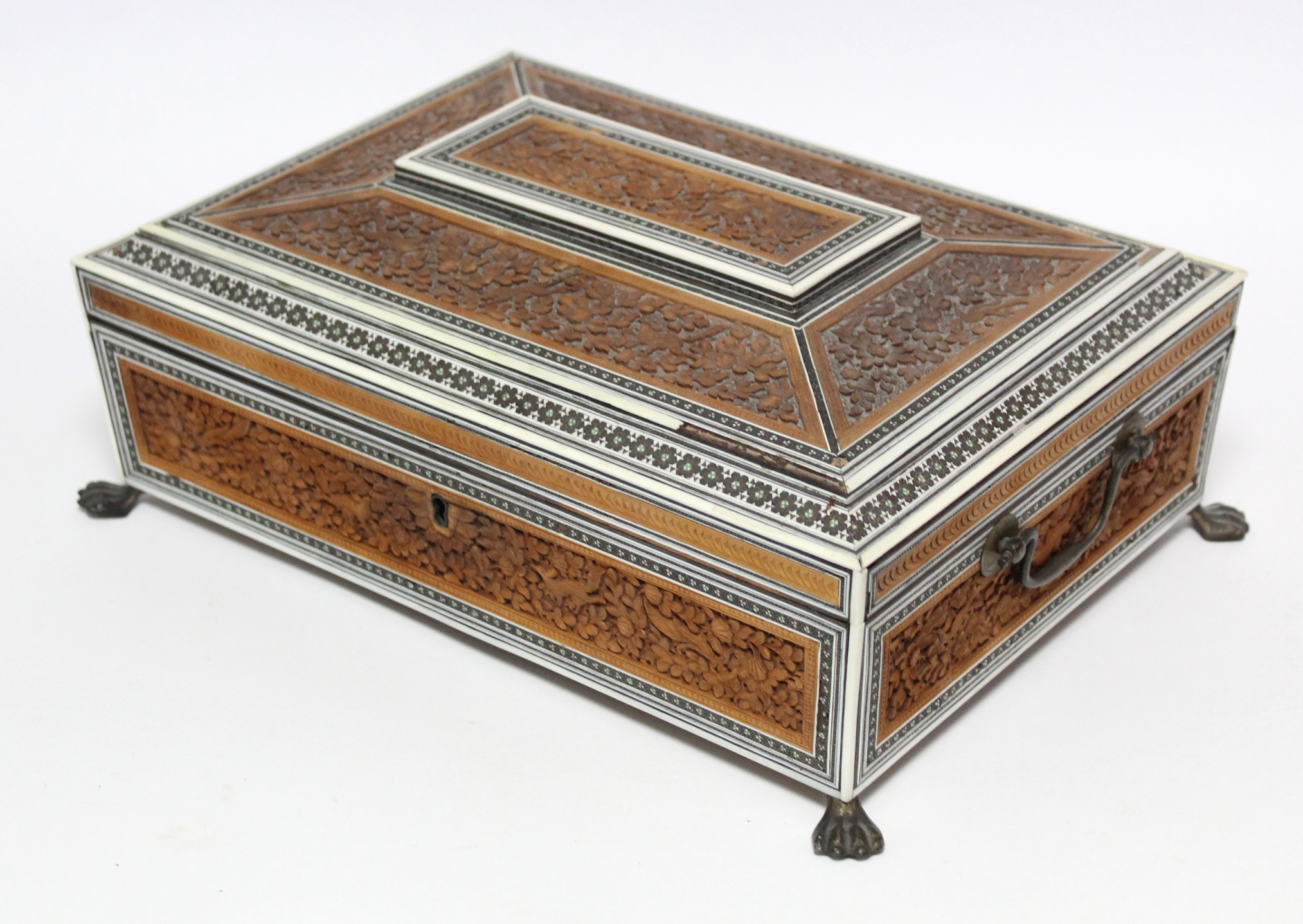 Lot 161 - A 19th century Anglo-Indian sandalwood & ivory needlework box with hinged lid, profusely carved with
