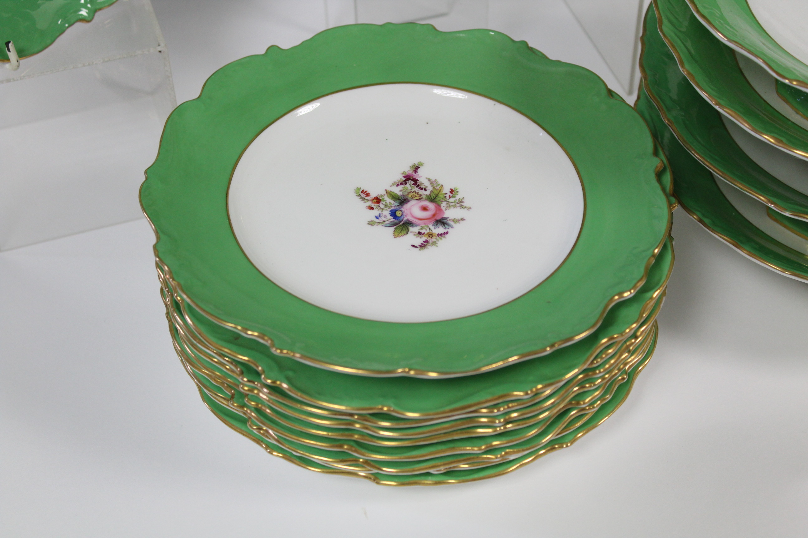 A Coalport porcelain dessert service with wide apple-green borders & moulded gilt rims, each piece - Image 3 of 3