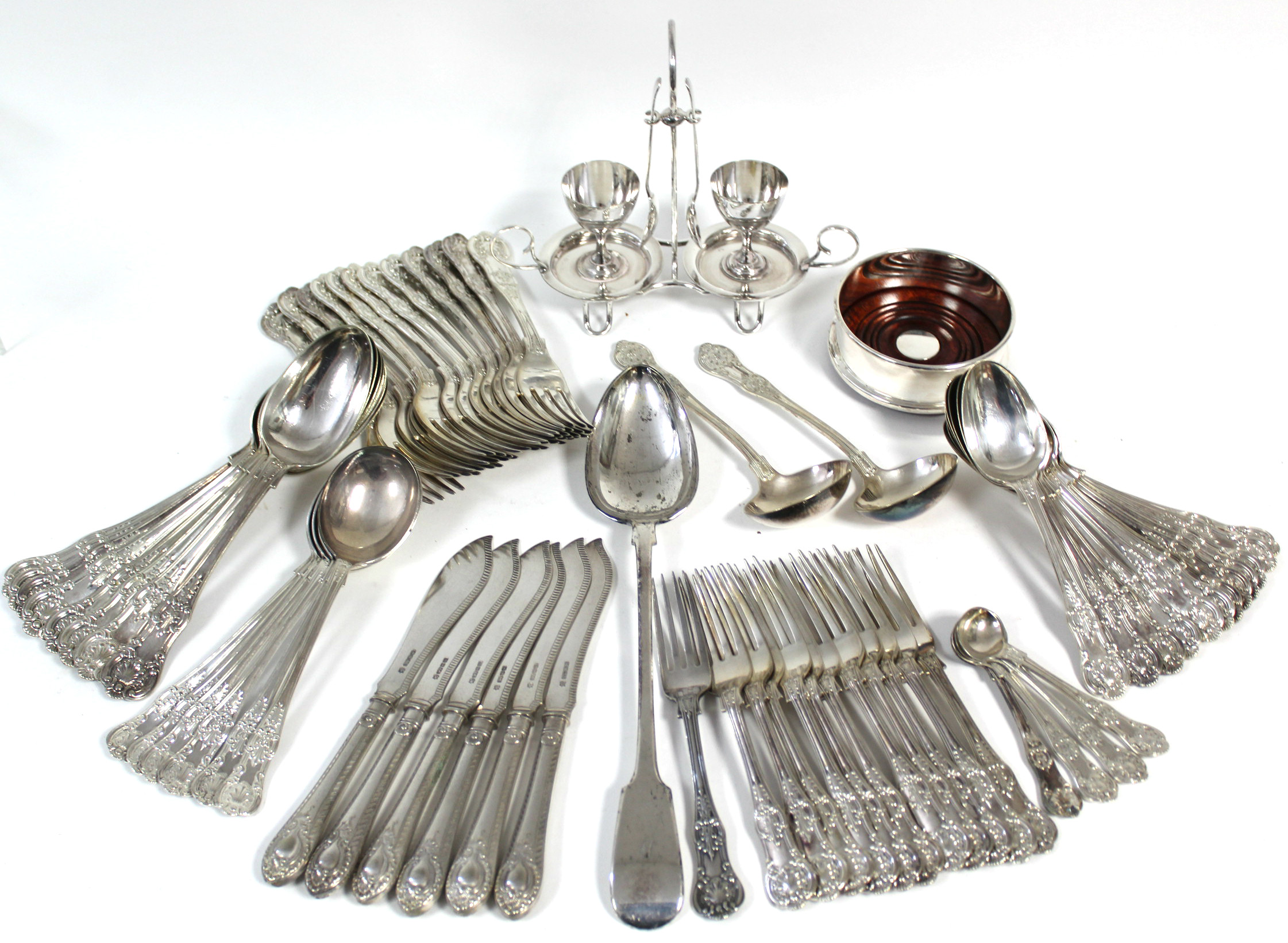 A part service of Queen's pattern flatware, comprising: eight table spoons, twelve table forks,