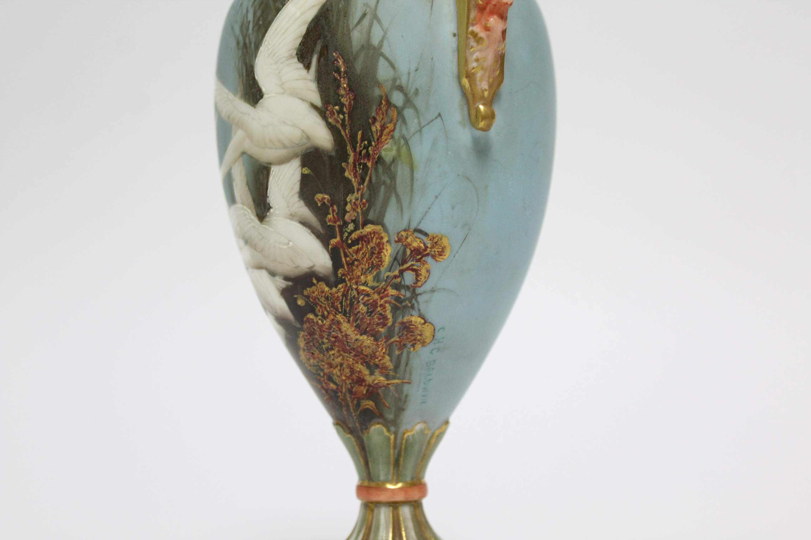 Lot 58 - A ROYAL WORCESTER PORCELAIN TWO-HANDLED VASE, the slender ovoid body painted with swans in flight by