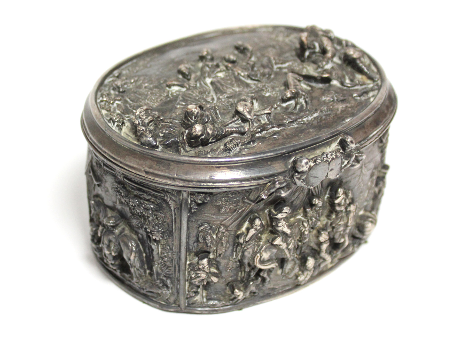A continental white metal oval box, decorated in relief with scenes of huntsmen, figures & animals - Image 7 of 9