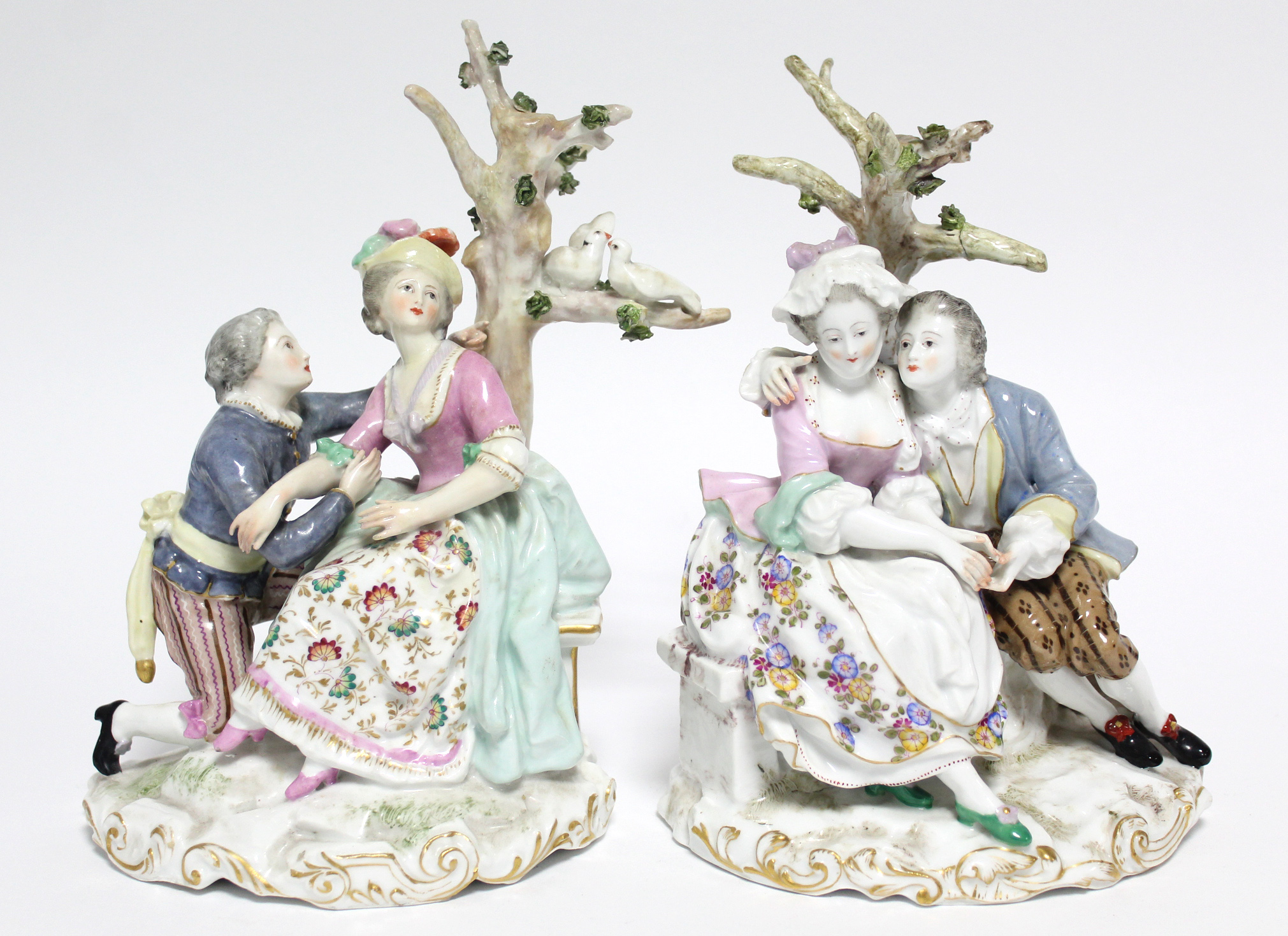 A pair of Samson porcelain romantic male & female figure groups, each dressed in colourful 18th