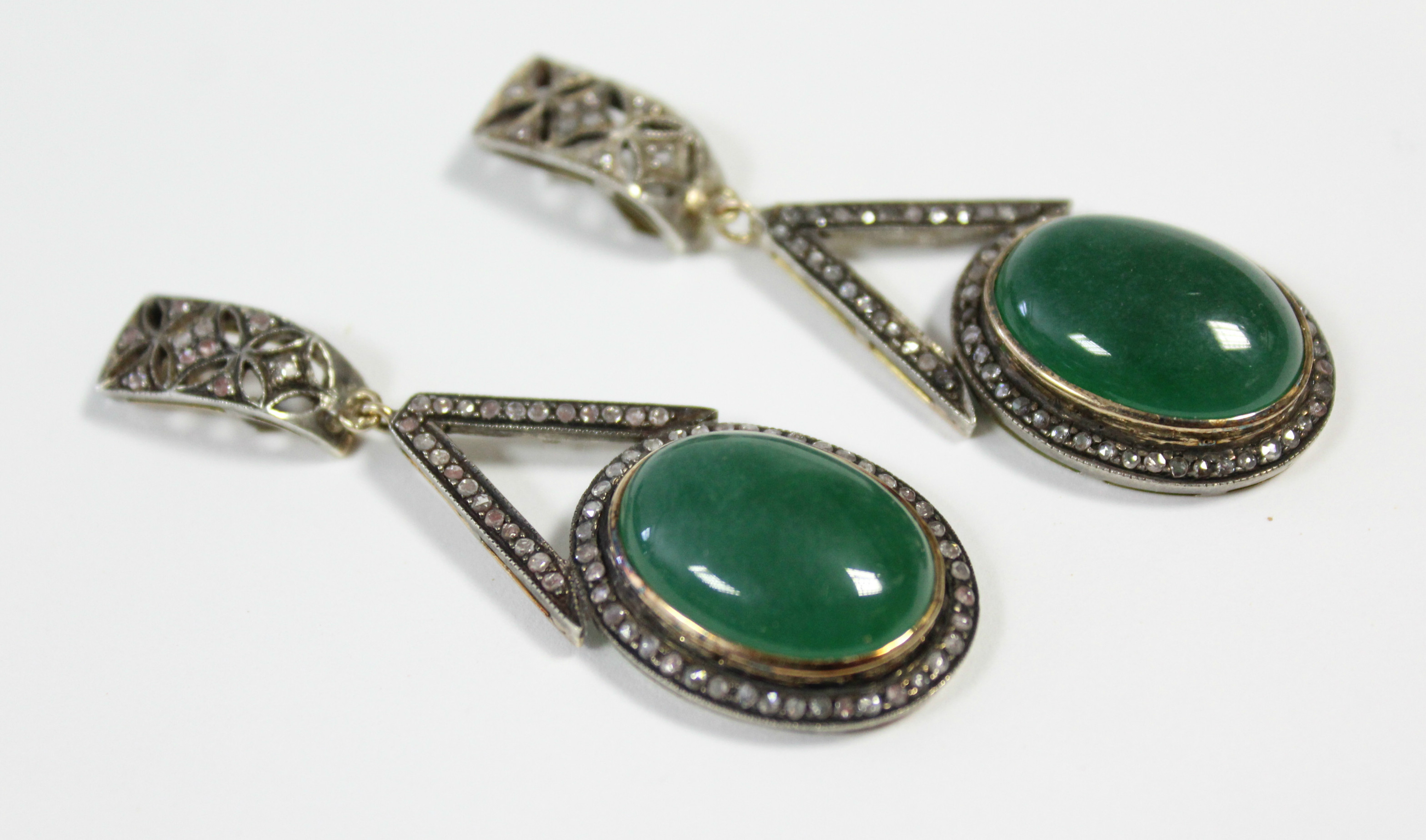 A PAIR OF JADE & DIAMOND PENDANT EARRINGS, each with oval green jade cabochon suspended from an - Image 2 of 6