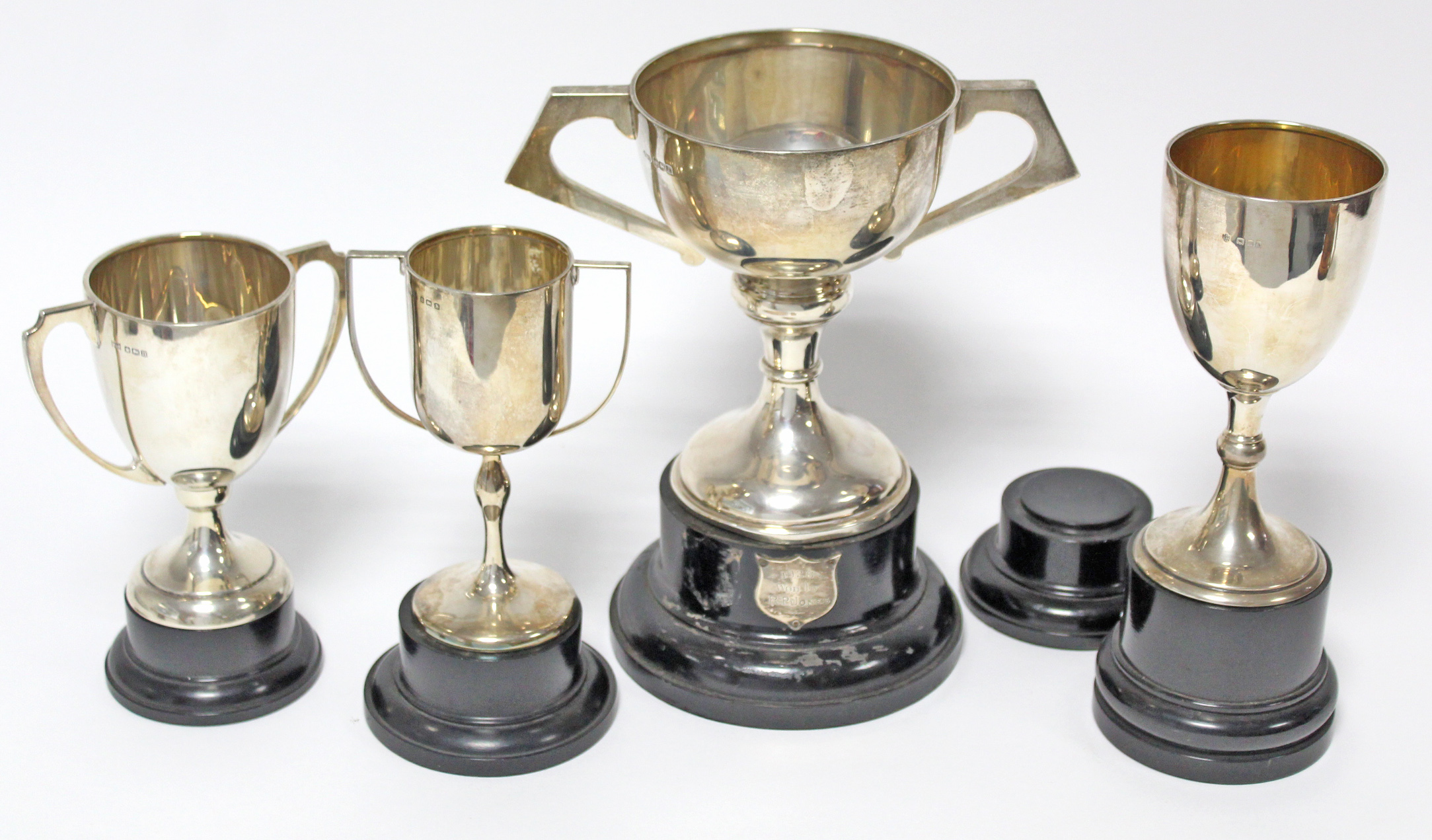A George V two-handled trophy cup, Sheffield 1924, by Fattorini & Sons Ltd; together with three