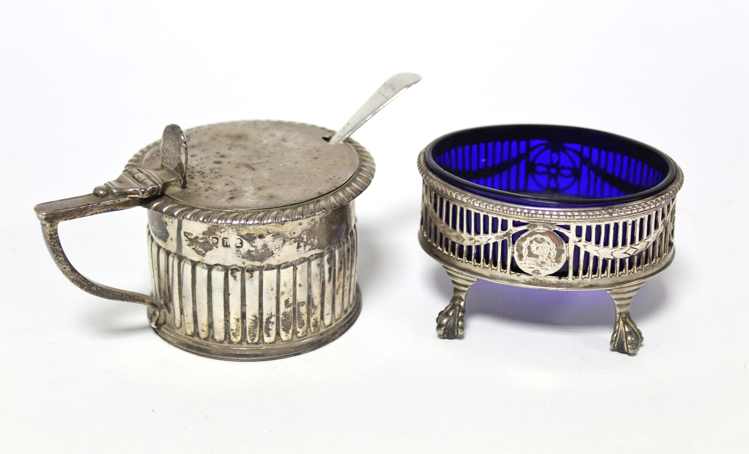 Lot 23 - A George IV cylindrical mustard pot with fluted sides & hinged lid; London 1823, by William Eaton; &