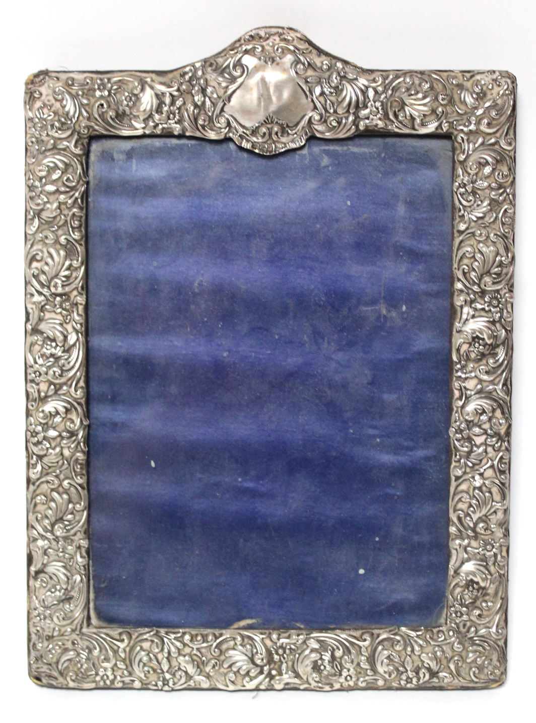A late Victorian rectangular photograph frame with all-over embossed floral decoration, Sheffield