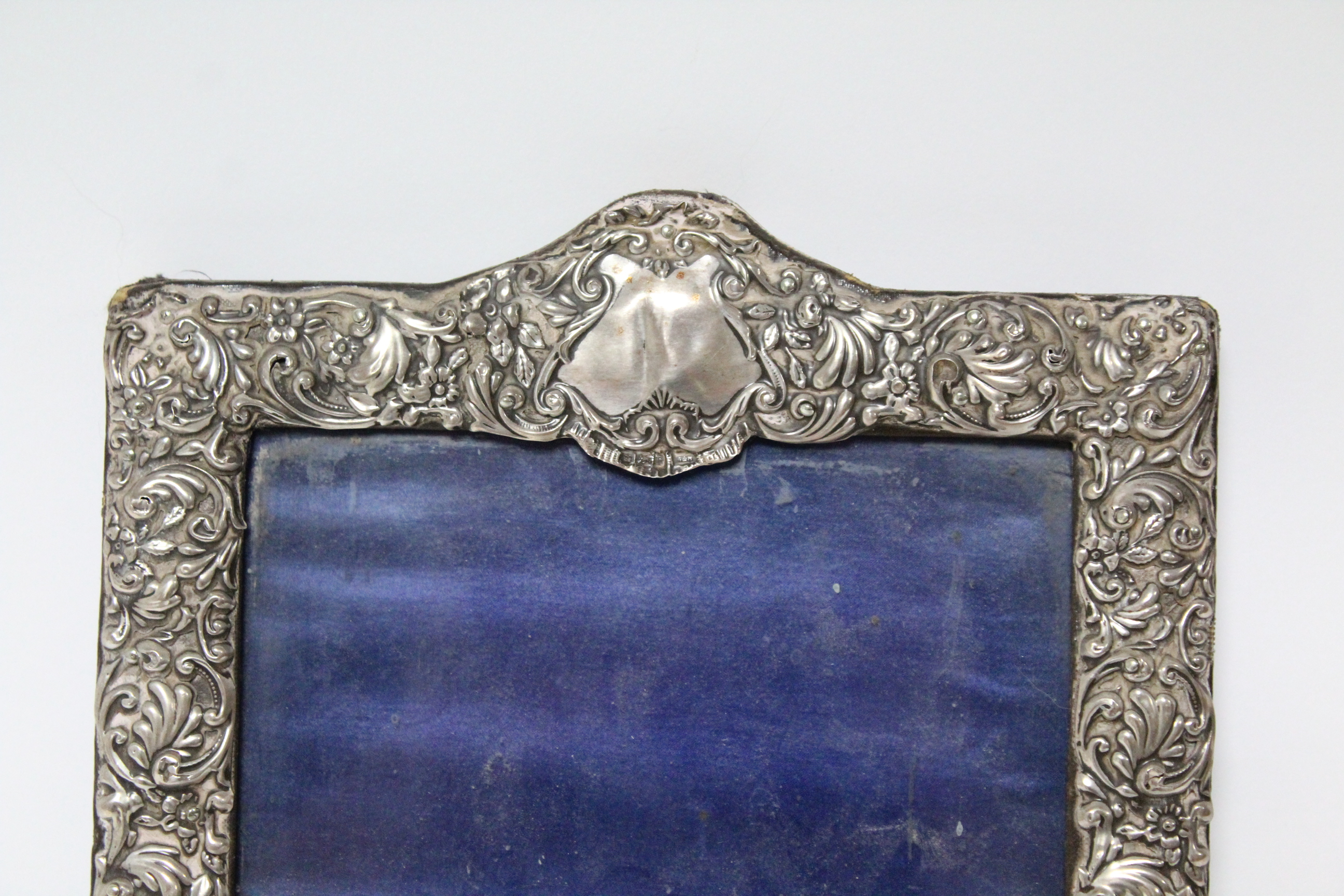 Lot 21 - A late Victorian rectangular photograph frame with all-over embossed floral decoration, Sheffield
