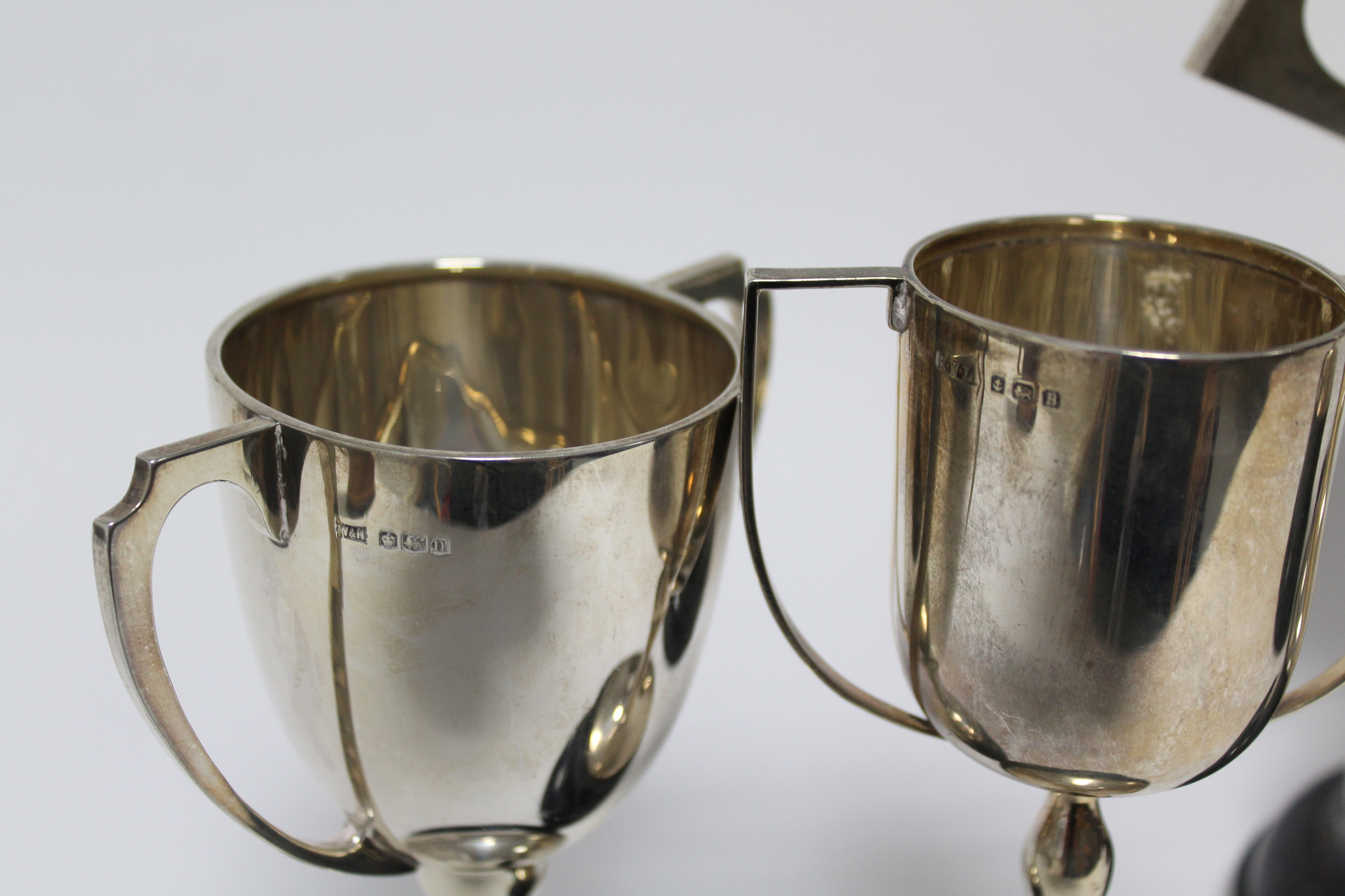 Lot 12 - A George V two-handled trophy cup, Sheffield 1924, by Fattorini & Sons Ltd; together with three