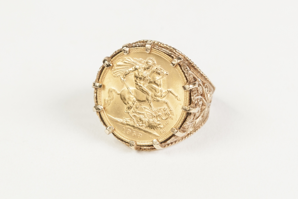 Lot 7 - 1958 GOLD SOVEREIGN (VF) claw set in 9ct gold ring with pierced decoration, 15.2 gms gross
