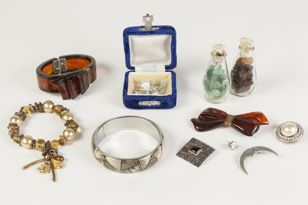Lot 341 - BROWN PLASTIC BOW PATTERN SPRING HINGED BANGLE and bow BROOCH; bead BRACELET; metal crescent moon