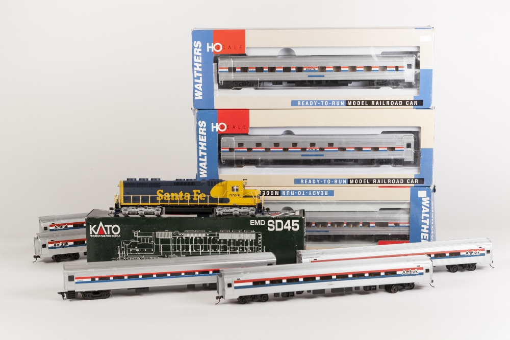Lot 397 - WALTHERS USA THREE BOXED H0 GAUGE AMTRAK COACHES viz lounge and two sleeper cars in silver, red,