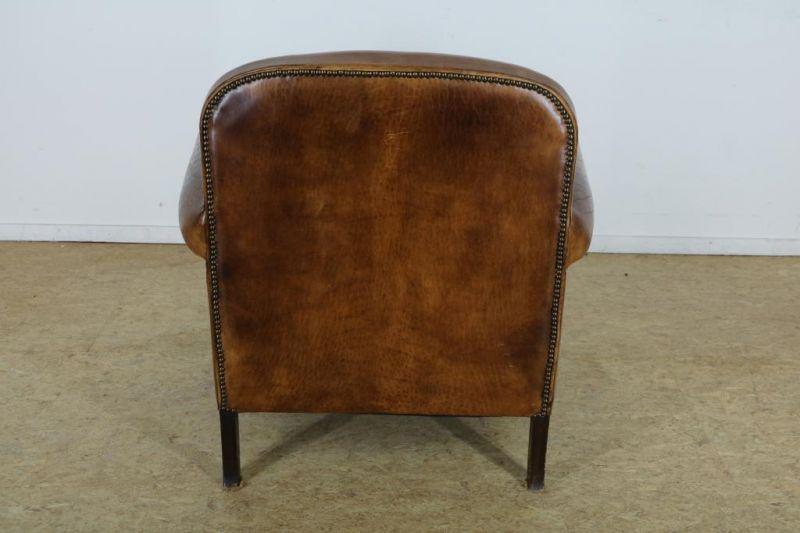 Los 55 - Bruin lederen fauteuil op Queen-Anne-stijl pootjes, ca. 1920.