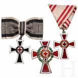 Three Red Cross awardsBrustkreuz des Marianerkreuzes des Deutschen Ritterordens an Damenschleife,