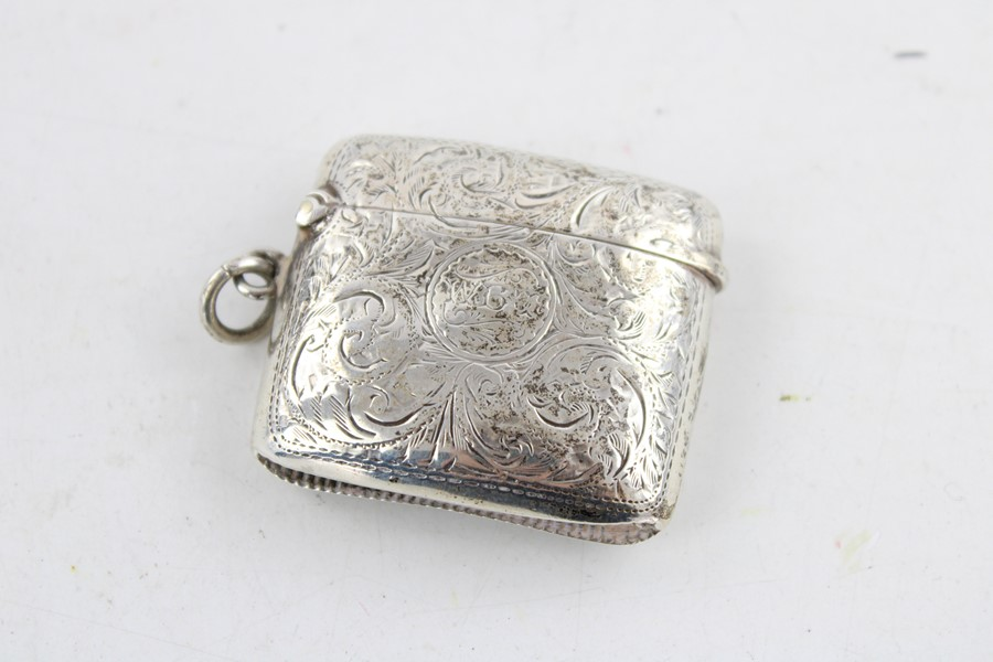 Lot 46 - Antique hallmarked 1900 Chester silver curved vesta case with floral leaf engraving, personalised c