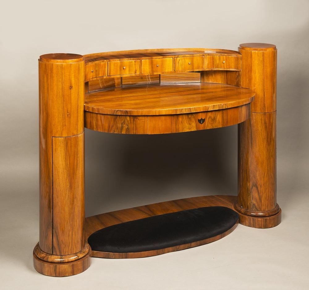 JOSEF DANHAUSER (1805-1845): A LADY'S DESK 1830 99x139x61 cm Walnut, oak. An oval Biedermeier