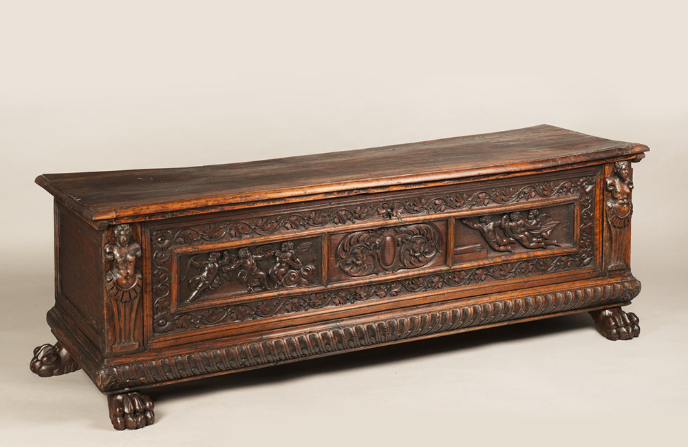 A MANNERIST CHEST Early 17th century; Northern Italy 57x168x52 cm Walnut. A richly carved
