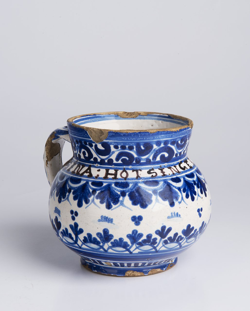 A SMALL PITCHER 10,5 cm Faïence, white glaze, painted in grand feu colors. Small pitcher with a