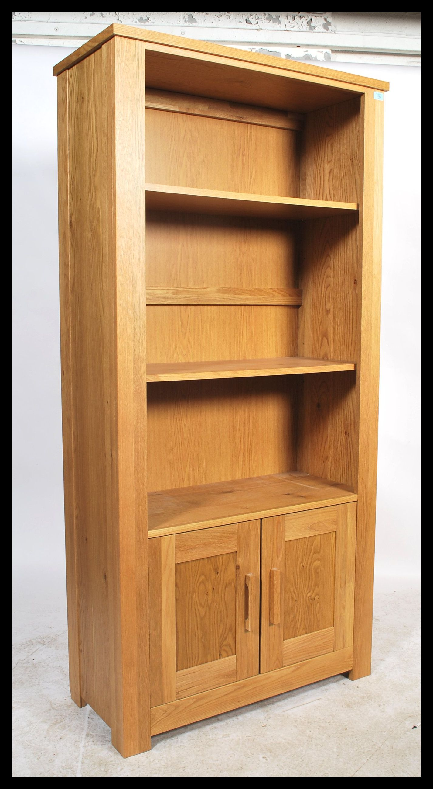 A Contemporary Chunky Oak Upright Bookcase Cabinet With