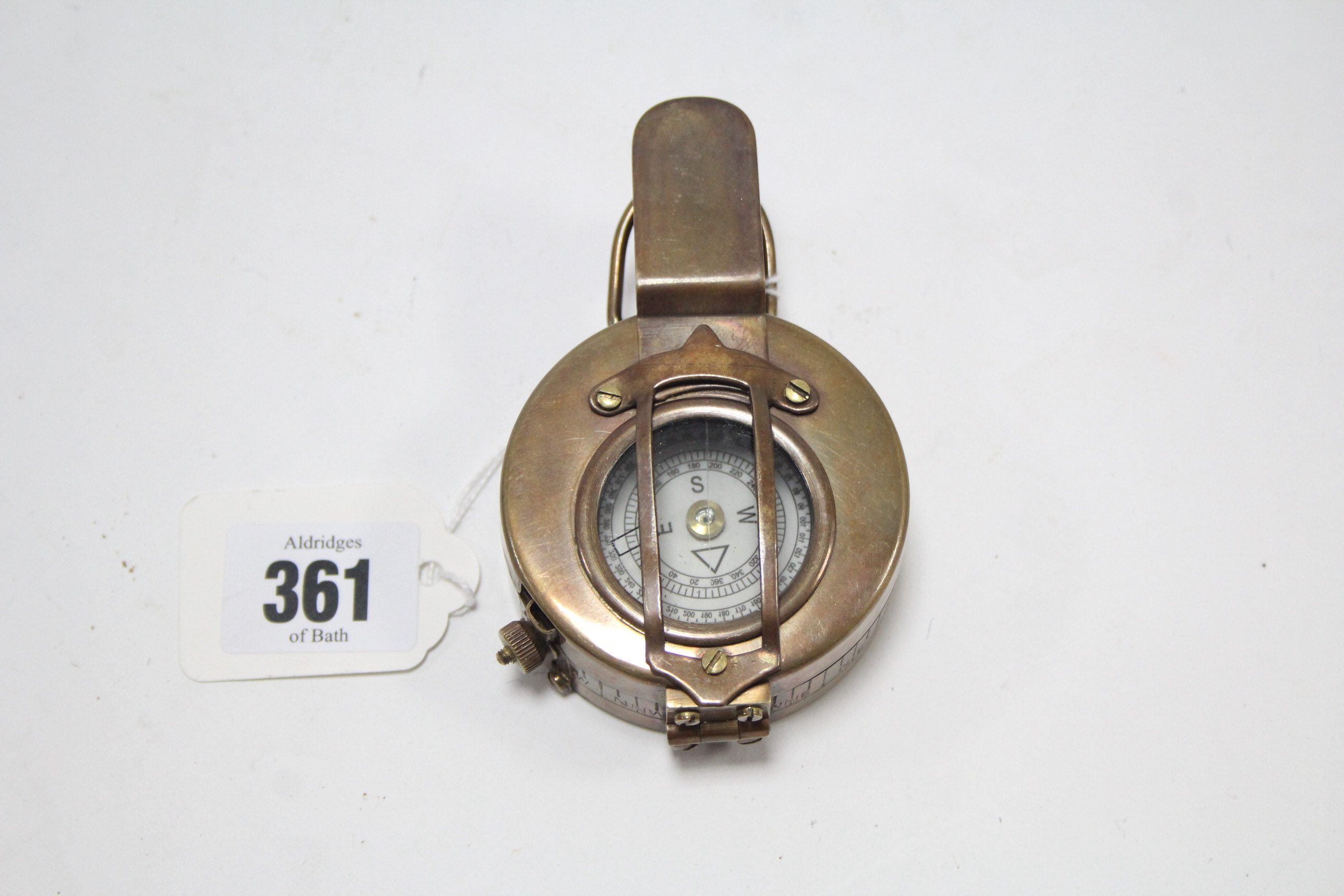 Lot 361 - A reproduction WWII brass compass.