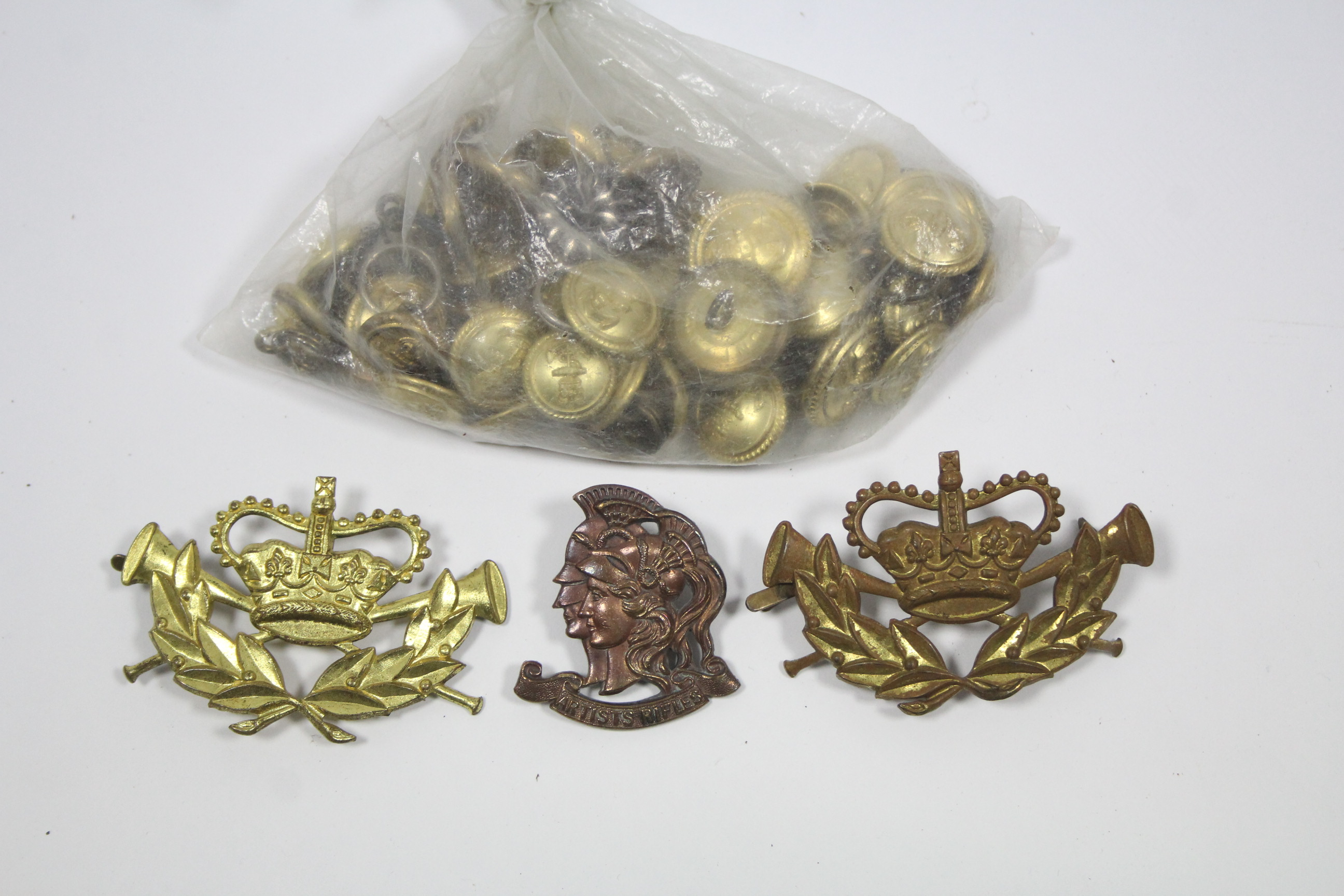 "Lot 173 - An ""Artist's Rifles"" regiment cap badge; two other cap badges; & various Royal Navy tunic buttons."