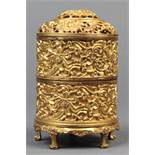 Chinese gilt alloy tiered censer, the openwork lid with and the exterior of the cylindrical tiers