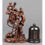 (lot of 2) Chinese wood carvings: first, a thumb ring box with a dome lid, fronted by an