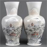 Pair of Chinese enameled porcelain vases, of a snowy landscape with figures and pavilions,