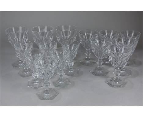 A set of six Baccarat French crystal white wine glasses, six matching red wine glasses, and three water glasses in the Harcou