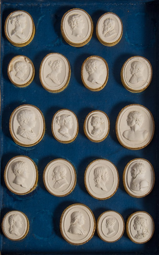 Lot 35 - Grand Tour Intaglios : a collection of 32 Italian plaster intaglios rimmed in gilt,