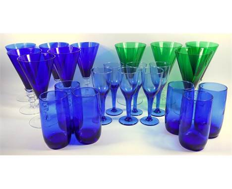 A group of blue and green conical form wine glasses,  a Nailsea type rolling pin and other drinking glasses