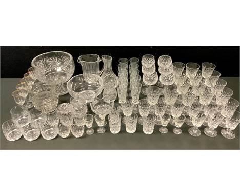 A large cut glass pedestal bowl; another footed bowl; a part suite of cut glass glasses including champagne flutes, hock, red