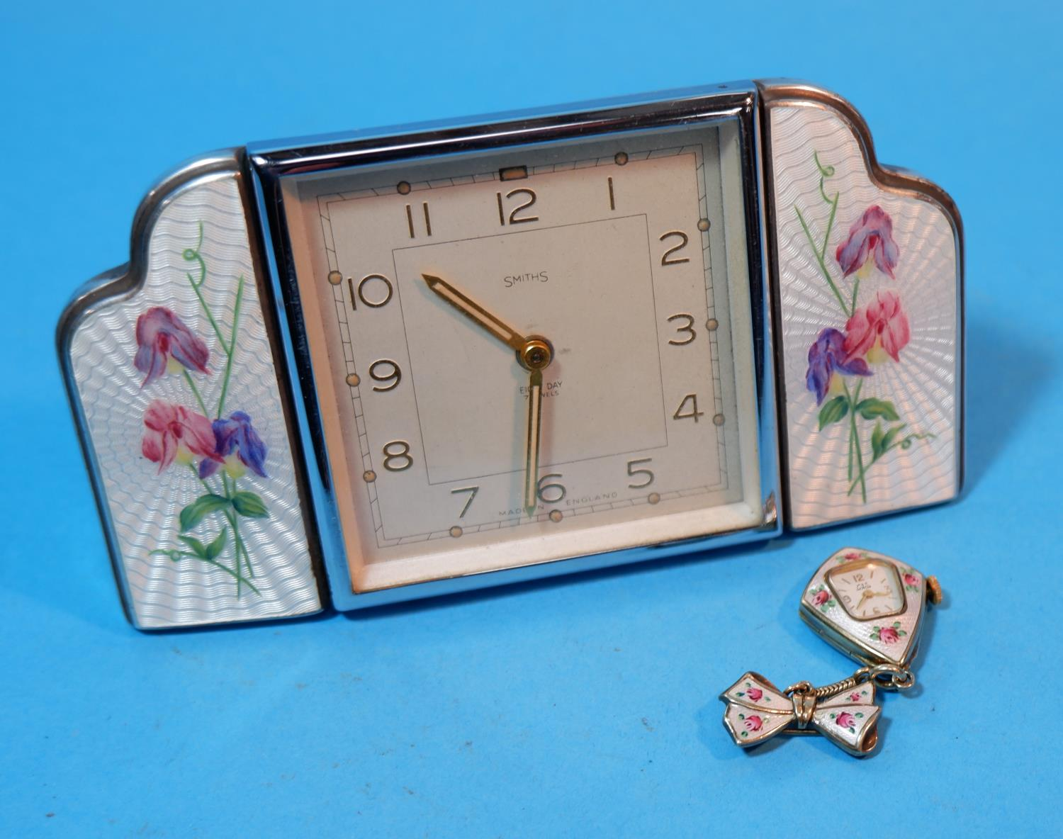 Lot 195A - A 1930's Smiths dressing table clock with square chrome framed central clock flanked on either