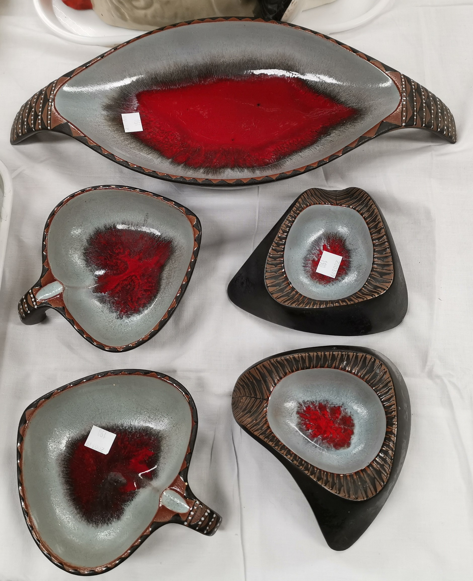 """Lot 190 - A 5 piece """"Kalahari"""" glazed pottery cocktail set comprising oval bowl and 4 small dishes"""