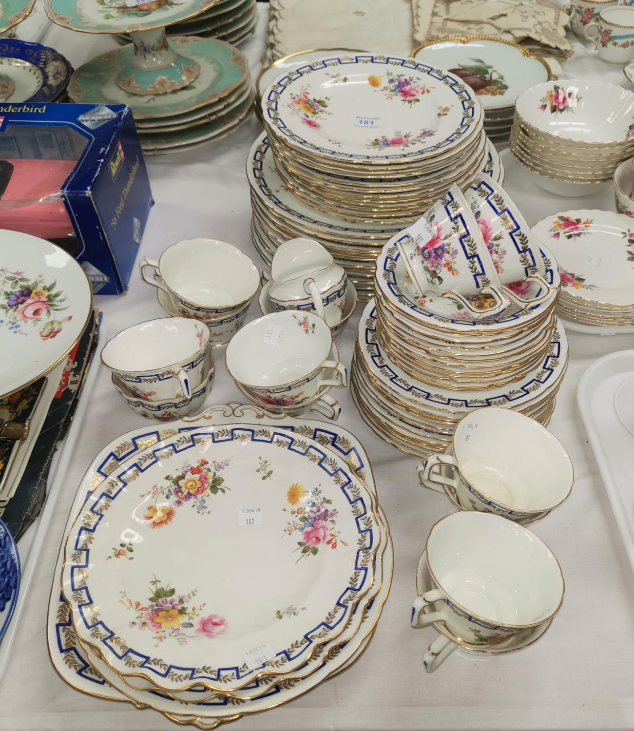 Lot 181 - A Royal Crown Derby dinner and tea service with polychrome bouquets of flowers and intertwined