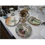 A large Doulton Lambeth jug and Doulton plates