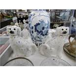 A pair of Staffordshire dogs with glass eyes